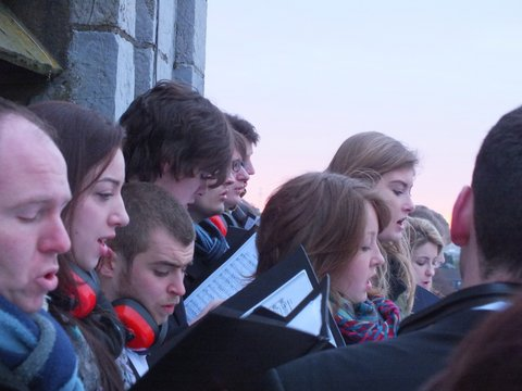 The Choir Crowds outdoors near the top of the tower of Saint Anne's Shandon to sing in summer!