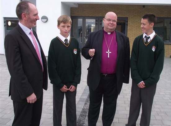Ashton School Principal, Adrian Landen (left) and the Bishop chat with two First Years, both of whom are grandsons of teachers who taught the Bishop during his years at Ashton.