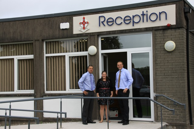 Midleton College Principal, Mr Simon Thompson, speaks with two staff members outside the reception and administration block, Ms Niamh Lawlor and Mr Kevin Stanley.