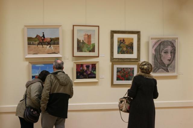 Contemplating a Purchase at Douglas Parish Art Sale and Exhibition