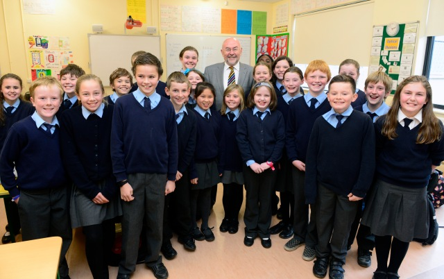 A jolly group of fifth class pupils with the Minister for Education and Skills, Mr Ruairí Quinn, T.D.  (Photo: Andy Ferreira).