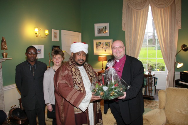 Sheikh Ihab Ahmed presents Bishop Colton with a Christmas Gift.