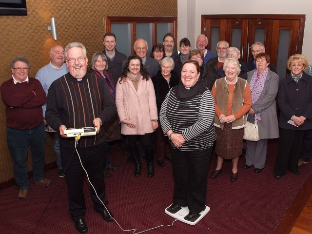 Pictured with their parishioners, at their first weigh in, were,  the Revd Elaine Murray, Rector, Carrigaline Union and Fr. Pat Fogarty, Parish Priest, Carrigaline Parish who are both doing a charity weight loss competition over the next few months in support of the Carrigaline & District Lions Club initiative to provide a Youth Club for Carrigaline.