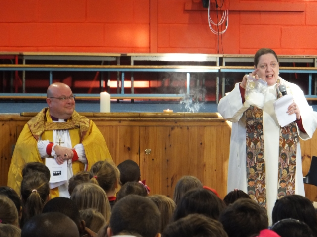 The Bishop of Cork, Cloyne and Ross (left) and the pupils of St Mary's Church of Ireland National School, Carrigaline, Co Cork, listen as the rector, the Reverend Elaine Murray (right) explains and shows the difference in smell between frankincense and myrrh.