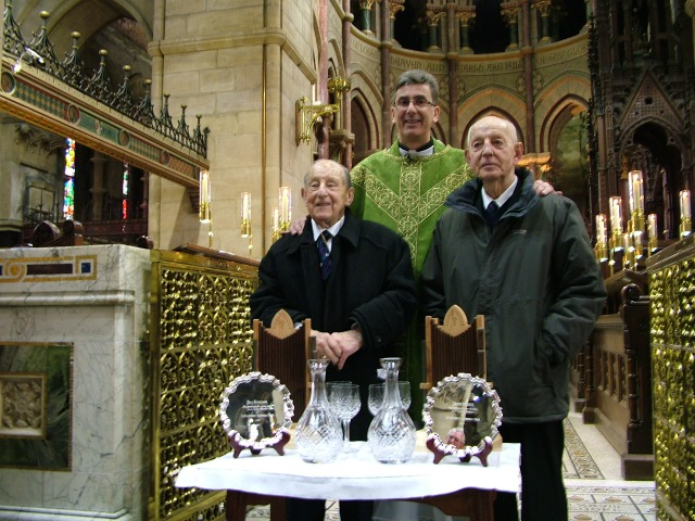 l-r: Bill Cavanagh, The Very Reverend Nigel Dunne (Dean of Cork), Edwin Vincent following the presentation of gifts in thanksgiving for their decades of service to the cathedral choir and vestry at St Fin Barre's Cathedral, Cork.