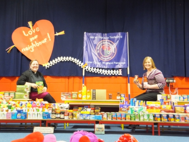 The Revd Elaine Murray, Rector of Carrigaline Union (left) and Ms Valerie Elliffe, Principal of St Mary's N.S. Carrigaline with the school-children's 'Love Your Neighbour' gifts for Cork Penny Dinners on St Valentine's Day