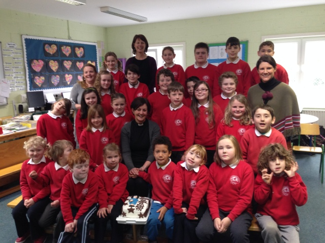 Anne is pictured with the staff and pupils! the cake (baked and iced by parent Ruth Levis O'Donovan) looks pristine now but was demolished moments later. The 'healthy eating' policy was suspended!