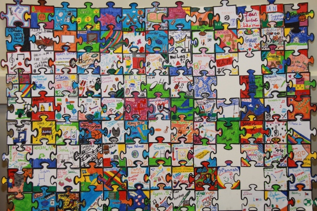 Each participant created a personalised jigsaw piece which were pieced together to make a bigger picture, with open edges and spaces for other to join in - no closed edges.