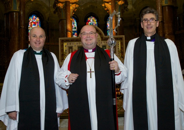 The new Archdeacon of Cork, Cloyne and Ross, the Venerable Adrian WIlkinson (left), following his licensing by the Bishop of Cork, Dr Paul Colton (centre) and his installation in the Cathedral Chapter by the Very Reverend Nigel Dunne, Dean of Cork (right).  Photo:  Neil Danton