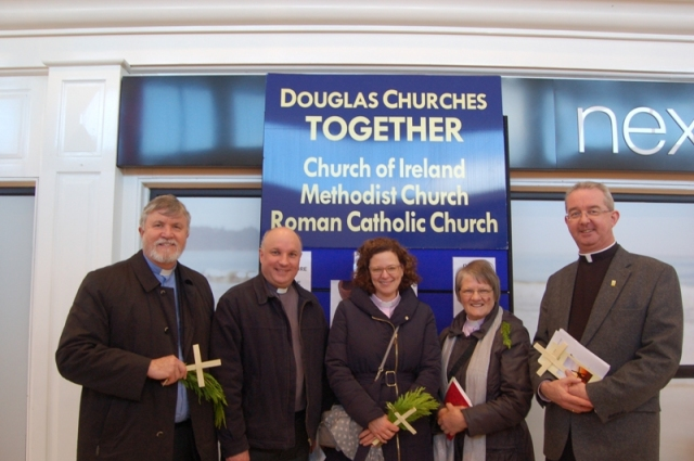 Setting up one of the two shopping centre Holy Week stalls are the local clergy from Douglas Churches Together l-r:  the Reverend Bill Mullally (Methodist), Archdeacon Adrian WIlkinson, the Reverend Sarah Marry and the Reverend Hazel Minion (Church of Ireland), and the Very Reverend Christopher Fitzgerald (Roman Catholic).