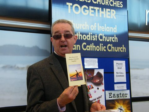 Father Christopher Fitzgerald highlights the Holy Week leaflet specially prepared by Douglas Churches Together.