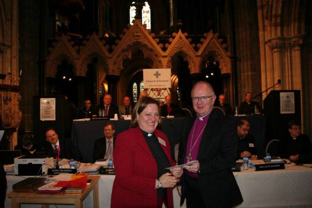 The Reverend Elaine Murray collects the prize from the Archbishop of Armagh, the Most Reverend Dr Richard Clarke.
