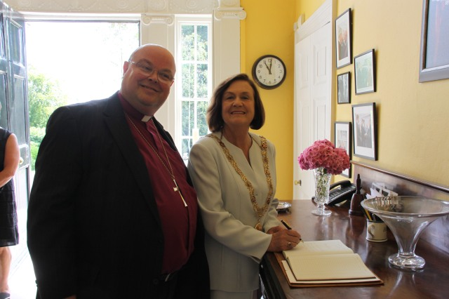 The Lord Mayor of Cork, Cllr Mary Shields (right), signs the visitors' book to mark her courtesy call on the Bishop of Cork.