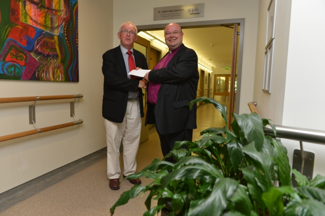 On behalf of St Luke's Home, Cork, Dr Paul Colton, Bishop of Cork (right) presents the final instalment of a €1 million donation to Marymount University Hospital and Hospice, Cork to the Marymount Chairman, Professor Cillian Twomey.  Photo:  Provision