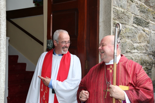 The Reverend Cliff Jeffers and Bishop Paul Colton share a joke at the door of  Saint Mary's Church, Dunmanway following the Service of Institution.