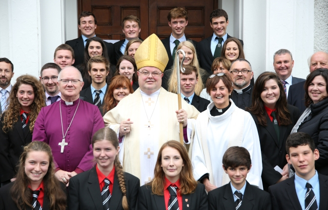 Students, teachers and members of the Board of Bandon Grammar School join (centre l-r) the Archbishop of Armagh, the Bishop of Cork and the Reverend Anne Skuse for a photograph after the dedication of the new school chapel.  (Photo:  Donal Warren)