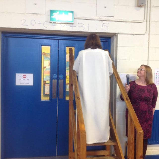The Reverend Elaine Murray, Rector of Carrigaline, checks the traditional Epiphany blessing with chalk on the lintel of the doorway.