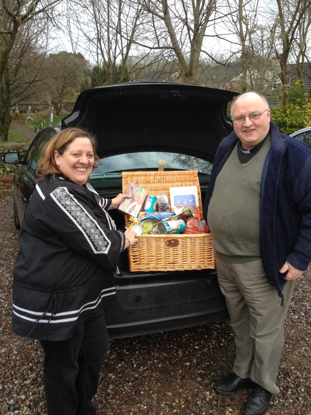 The Reverend Tony Murphy, Priest-in-Charge of Moviddy Union of Parishes hands over food items collected to the Reverend Elaine Murray, who had the idea of 'Love your Neighbour on St Valentine's Day.'
