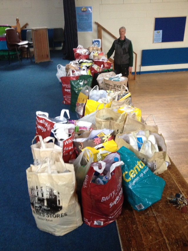 Pictured is Rowland Newenham in the Canon McCrea Hall, Carrigaline, preparing to load up the many bags into his van for delivery to Cork Penny Dinners.
