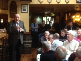 George Hook speaking in Bull McCabe's Bar to the Lenten Men'sBreakfast for the Parishes of Douglas Union with Frankfield