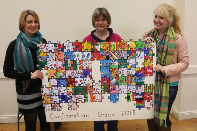Youth workers Hilda Connolly (left) and Kristin Hollowell (right) with Mrs Susan Colton (centre) with this year's Confirmation jigsaw  - a work in progress featuring pieces created by the young people.
