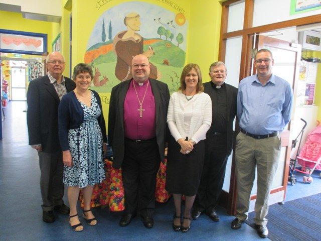 Members of the Board of Management and school staff welcome the Bishop to South Abbey National School.