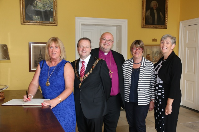 l-r the Lady Mayoress (signing the visitors' book), the Lord Mayor of Cork, the Bishop and Mrs Susan Colton,