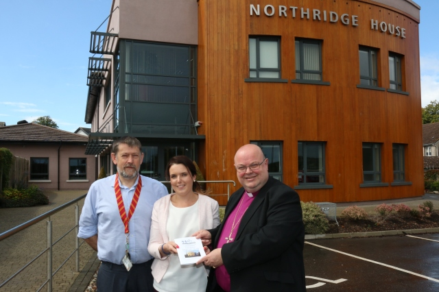 On a visit to St Luke's Home Education Centre, Cork at Northridge House, the CHairman of the Board, Dr Paul Colton, is presented with details of this year's courses by administrator Claire Coakley and the Director of Education, Bruce Pierce.