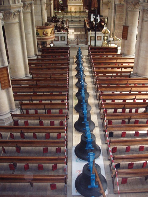 The bells of St Fin Barre's Cathedral, Cork lined up in the nave aisle at the time of their restoration, and the commissioning of new bells a number of year ago