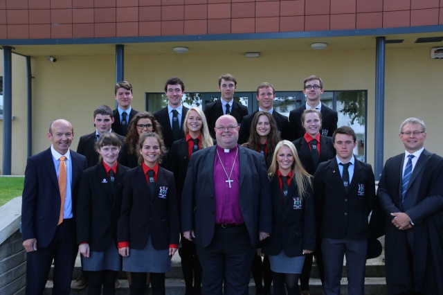 The new prefects at Bandon Grammar School wearing their ties presented to them by the Bishop (centre), with the Principal, Mr Ian Coombes (right) and the new Deputy Principal, (Mr Donal Warren (left)