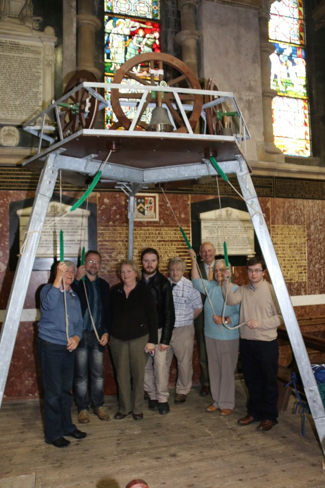 Some of the bellringers of St Fin Barre's Cathedral, Cork demonstrate their art on a miniature ring of bells set up temporarily in the north aisle of the Cathedral.