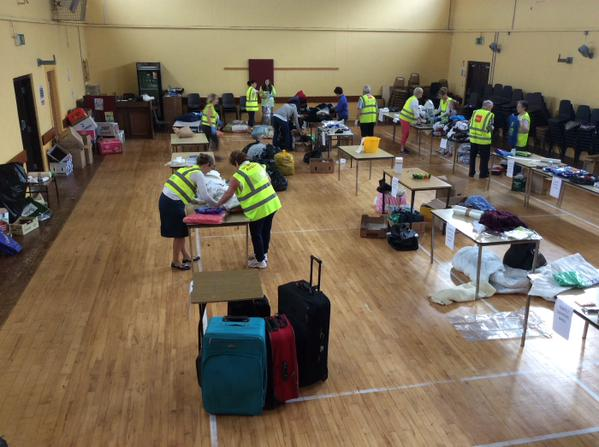 Community volunteers, including parishioners from Kinneigh Union of Parishes, sorting through donations at the BEDA Hall, Ballineen, for Syrian and other refugees.