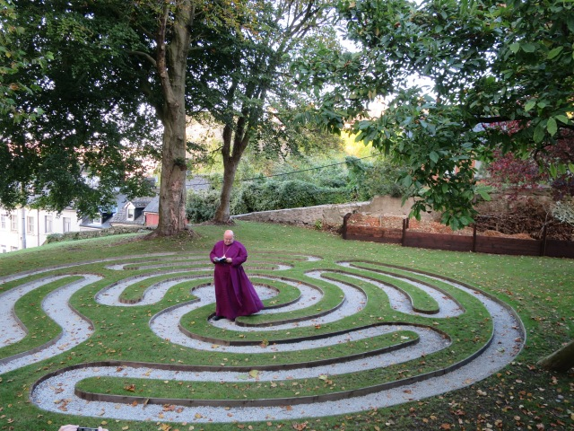 Bishop Colton journeys towards the centre of the labyrinth for the prayers of dedication.