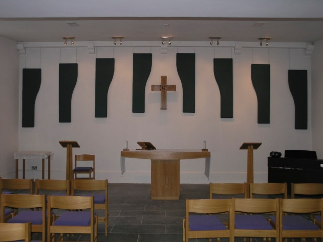 The new cross and panels,  altar candles and bookstand in the Chapel of the Holy Trinity in St Peter's Church, Bandon, County Cork