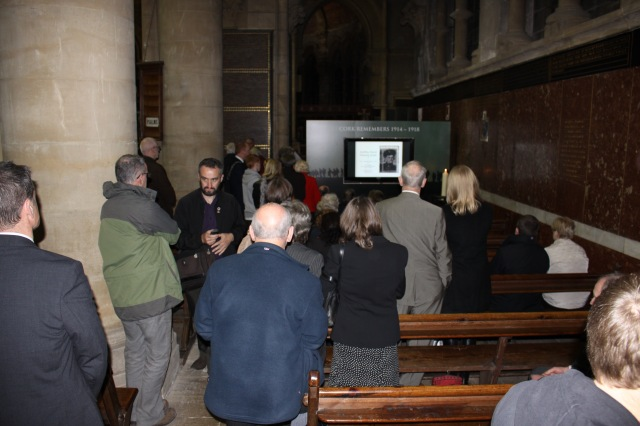Some of the congregation gathered before and after Choral Evensong to contemplate the names and stories of those who are included in the visual memorial.