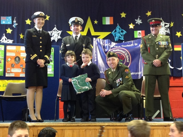 Óglaigh na hÉireann present the national flag to schoolchildren at St Mary's Church of Ireland National School, Carrigaline, County Cork