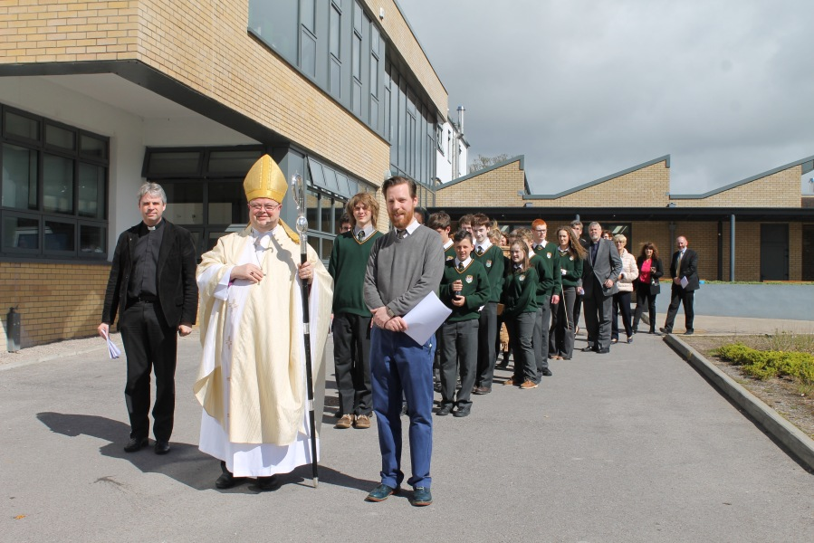 The procession from the sports hall at Ashton School, Cork to the chapel for the Liturgy of Re-Dedication.  Front 9r-l) school chaplain, Drew Ruttle, the Bishop of COrk, Dr paul Colton, and the Reverend David Bowles with, behind, students, staff and guests attending the Service.