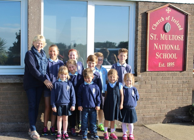 Elsie Gash (left) with her ten grandchildren, all of whom will be pupils at St Multose National School, Kinsale for the coming year.