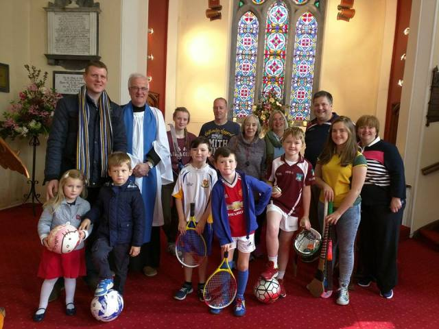 Diocesan Lay Reader, Richard Dring, from Carrigaline Union of Parishes, who presided at the recent All Age SPorts Service, surrounded by adults and young people who took part.