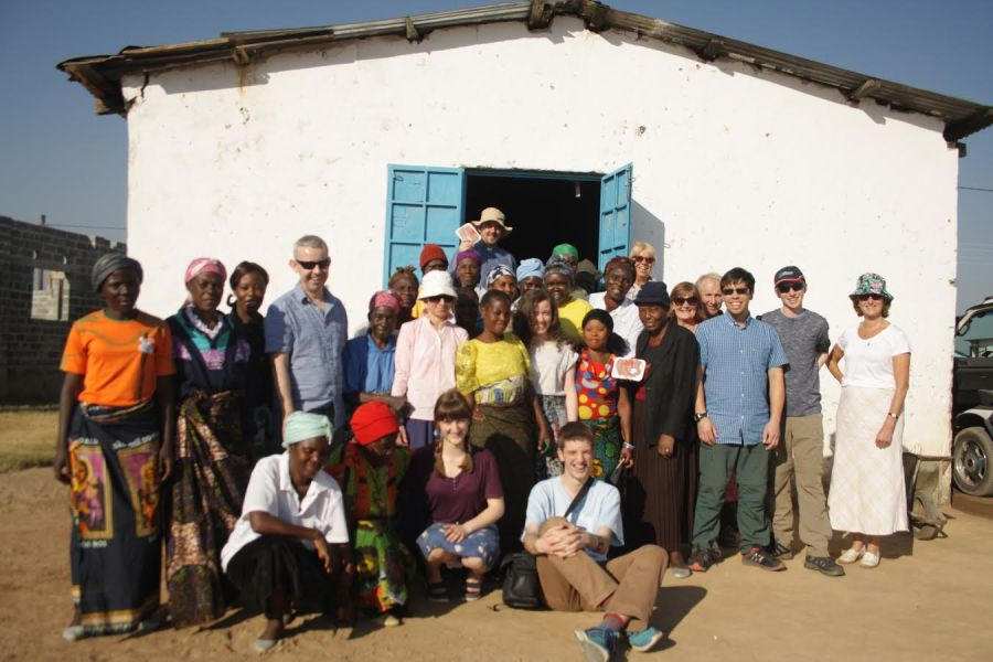 The team visiting Zambia meet with a local Women's Empowerment Grouop