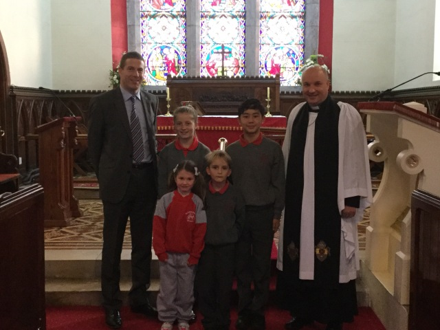 Dr Ronan Curtin, Consultant Cardiologist at Cork University Hospital (and parent of children at Saint Luke's National School, Douglas, Cork) with children from the school and therector, the Venerable Adrian Wilkinson in Saint Luke's Church, Douglas on Saint Luke's Day.