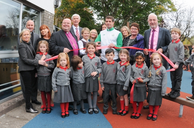 Pupils of Saint Luke's National School, Douglas, Cork at the official opening of their new soft play area with Irish Hockey Olympian, John Jermyn, Bishop Paul Colton, members of the fund-raising group, school principal Olwen Anderson, the rector, Archdeacon Adrian Wilkinson, chairperson of the school board, Roger Flack and Mr Liam Ryan of Ryan's SuperValue, Grange, Cork.