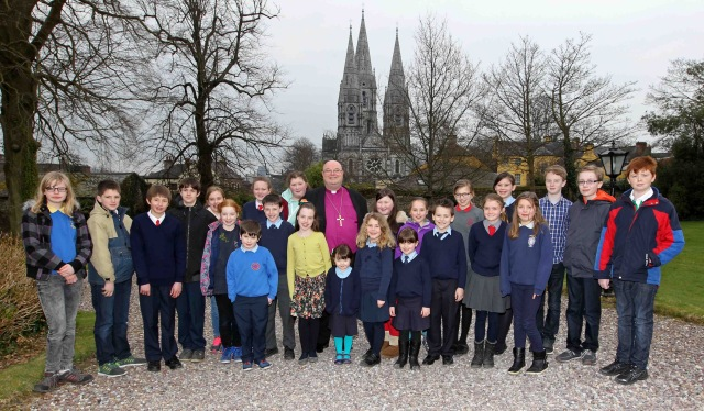 REPRO FREE. 17/03/2016 Saint Fin Barr's Cathedral, Saint Patrick's Day Festival and Civic Choral Eucharist, Cork. Pictured Bishop Paul Colton with School Children who presented Proclamations at the Service. the Bishop's Palace, after the Service. Picture: Jim Coughlan.