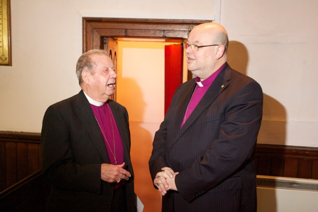 Bishop Paul Colton chatting with Bishop Samuel Poyntz.
