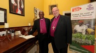 Signing the Visitors' Book, Archbishop of Burundi, The Most Reverend Martin Blaise Nyaboho, with the Bishop of Cork, the Right Reverend Dr. Paul Colton. Picture: Jim Coughlan.