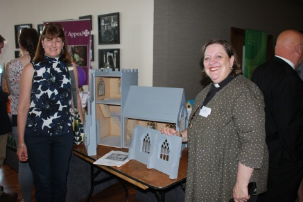 The Rev. Elaine Murray and Hilary Warren Perry with the church made by William Warren-Perry for the Children's Ministry Group